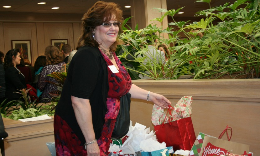 a woman smiling at the GROWS holiday breakfast