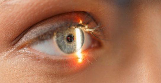 light shining on eye - Glaucoma Awareness Month eye exam