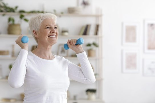 Senior woman working out with dumbells